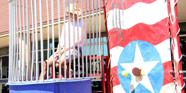 Administrator Derek Adams is introduced to the school at the Back to School Carnival.