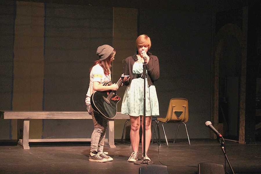 Senior Nikki Andrade and junior Carli Plymale perform an original song at Cafe Muse.