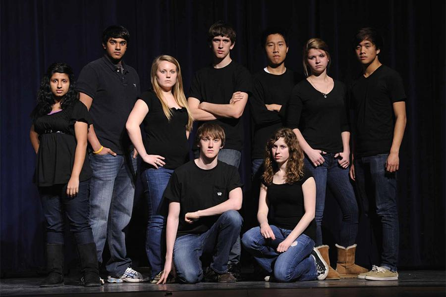 The 2012-2013 Outrage cast poses to stand against dating violence.