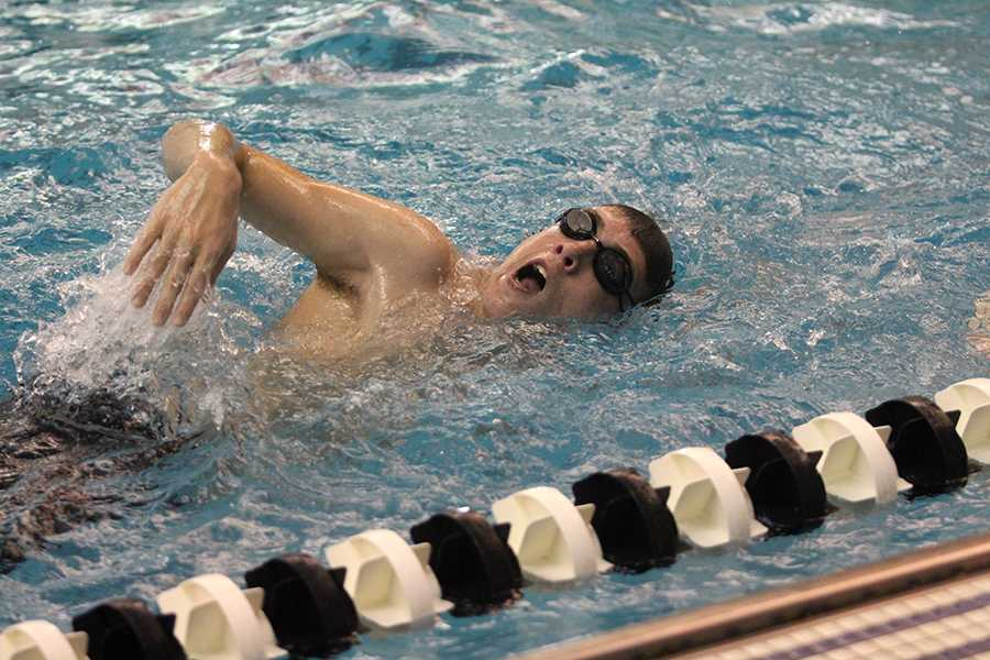 Sophomore Andrew Kastendick takes a breath between strokes during a practice warm-up. The boys first swim dual meet is Dec. 3 against Blue Valley Southwest.