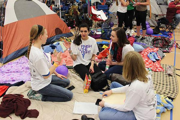 Junior Lauren Nordell-Morris, sophomore Nandita Daga, junior Suzanna Stephensen and ELA teacher Lindsay Gulbranson set up camp during the night.
