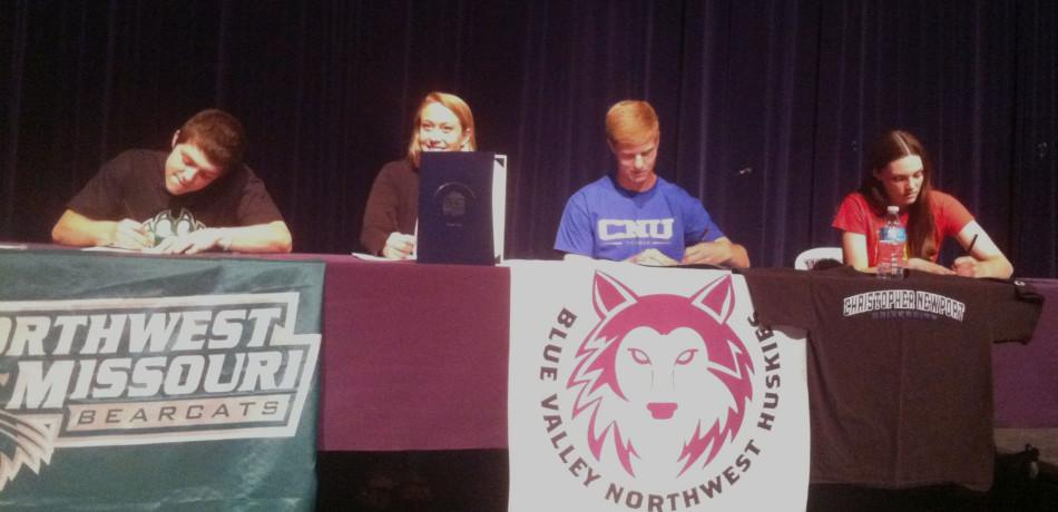 Four+athletes+commit+to+colleges+in+spring+signing