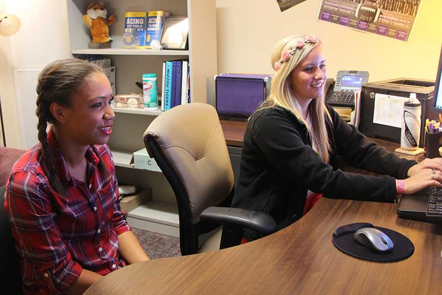 Counselor Jacelyn Miller meets with senior Kayla Conner during school to discuss college applications.