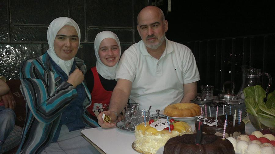 Junior Rama Bakir with her parents in Syria (photo courtesy of Rama Bakir).