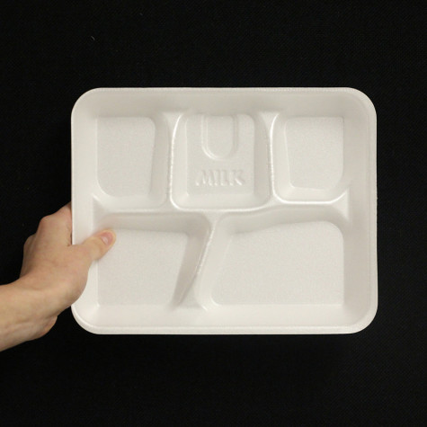 A letter from a styrofoam tray