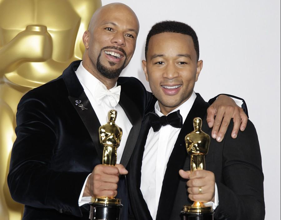 John Legend and Common hold their awards in the press room of the 87th Academy Awards on Sunday, Feb. 22, 2015, at the Dolby Theatre in Hollywood. (Francis Specker/Landov/TNS)