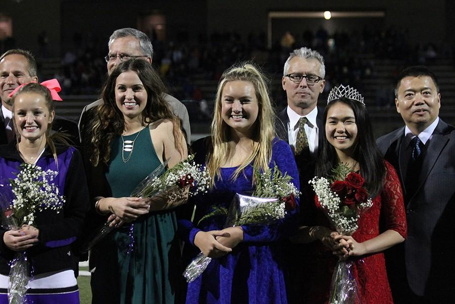 Homecoming Queen nominees line the football field during the Homecoming game Oct. 2.