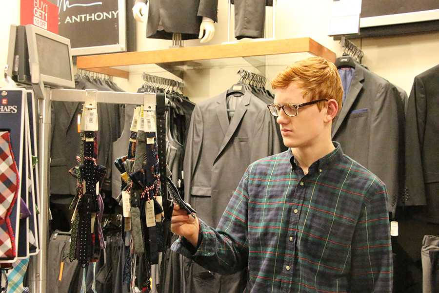 Senior Joey Mitchell shops for Sweetheart gear prior to the dance.