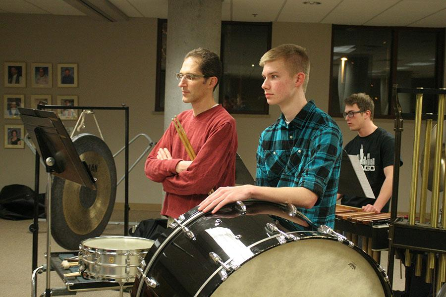 Senior Camden Hatley plays the bass drum at a rehearsal for the KC Civic Orchestra Feb. 23 at Lutheran Atonement Church.