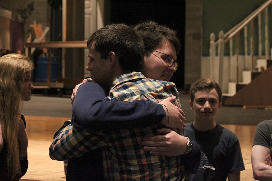 Choral Director Kevin Coker hugs choir student Alvar Negrete after the meeting where he announced his plans to leave BVNW.