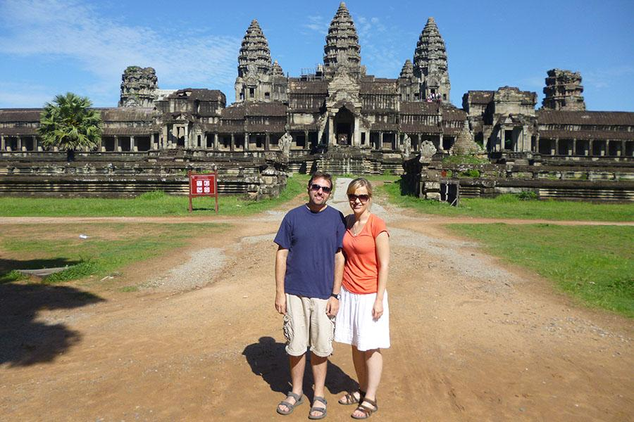Mike Arbucci stands with his wife in front of Angkor Wat just outside of Siem Reap during his summer trip to Cambodia, 2014 (photo courtesy of Arbucci).