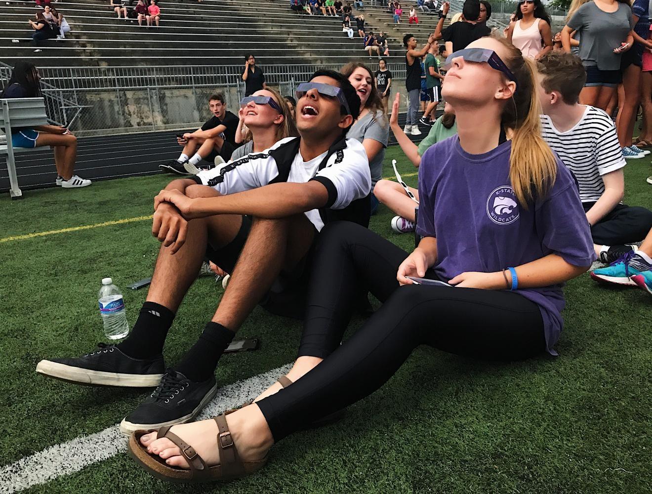 Juniors Quinn Wylie and Manav Mehta gaze at the solar eclipse.