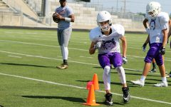 Senior wide receiver Zachary Stephens goes through a drill during a Husky football practice Tuesday Aug. 22.
