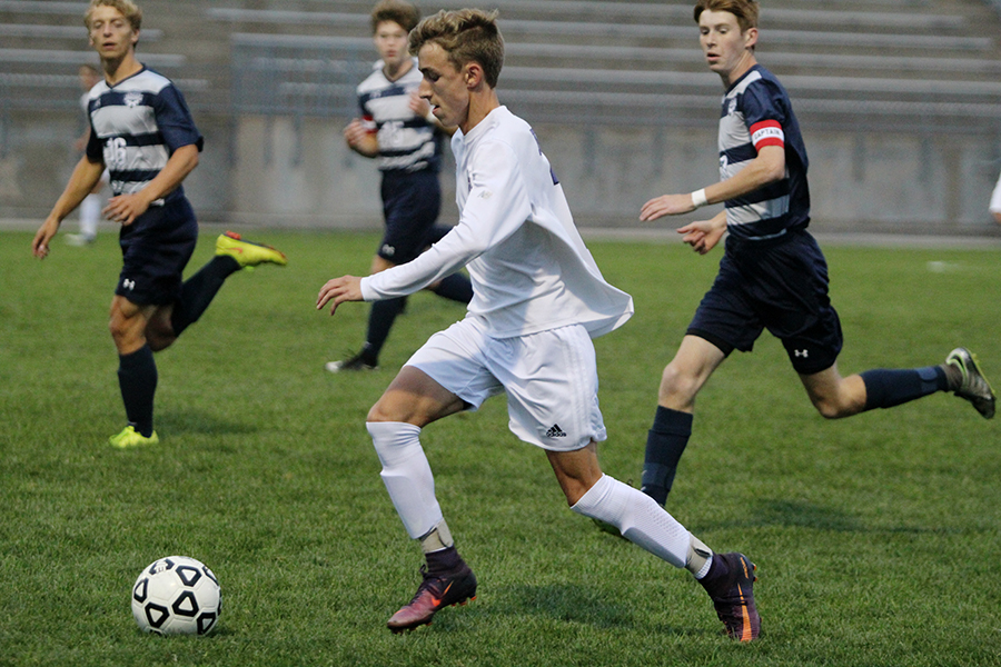 Senior+Mitch+Brill+%282%29+dribbles+the+ball+against+Mill+Valley+at+the+DAC+Sept.+26.