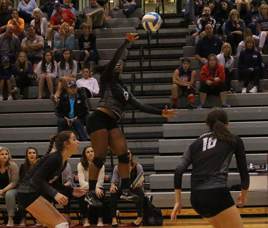 BVNW senior Stacie Williams (23) spikes the ball at Blue Valley West Oct. 21.