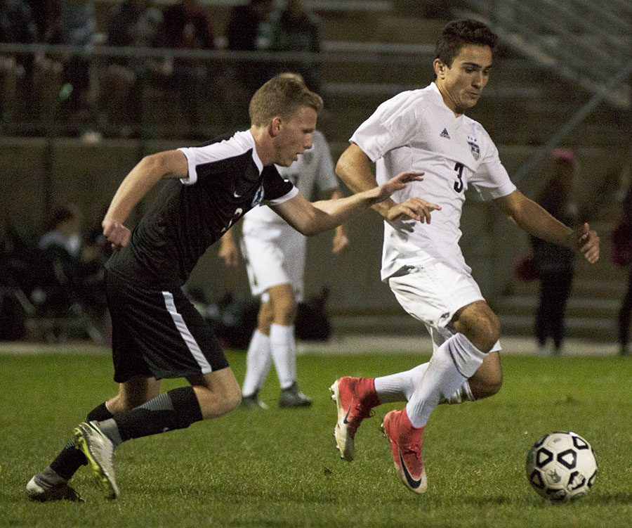 BVNW junior Kyle Pellen (3) dribbles the ball against Blue Valley Southwest at the DAC Oct. 17.