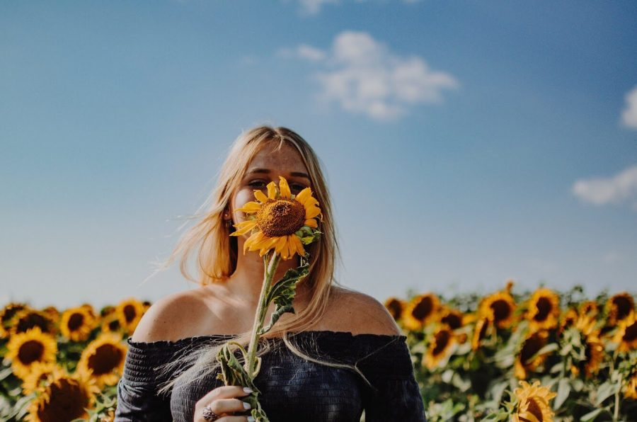 Senior Gracie Christie at Grinter Farms' sunflower field
