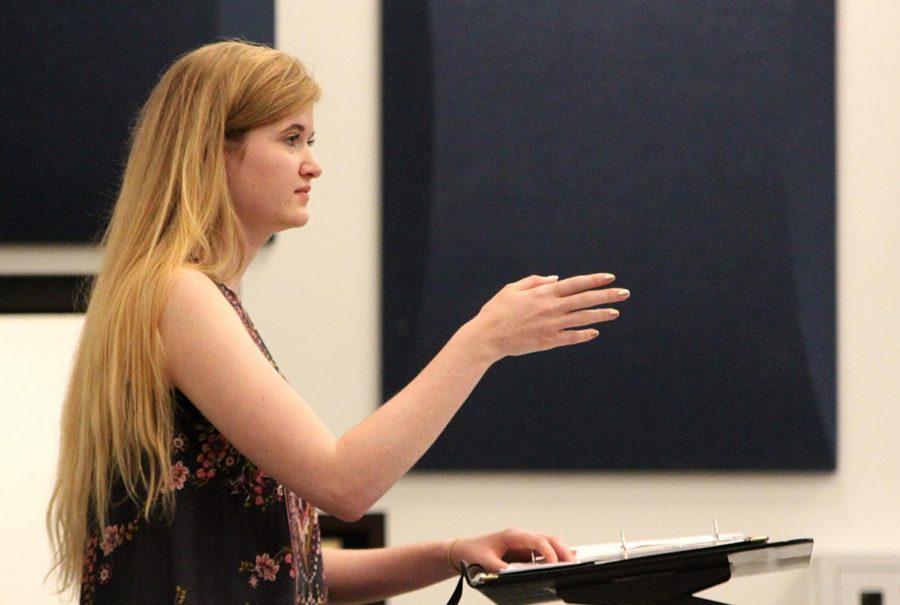Sallman conducts the freshman girls concert choir during their rehearsal.