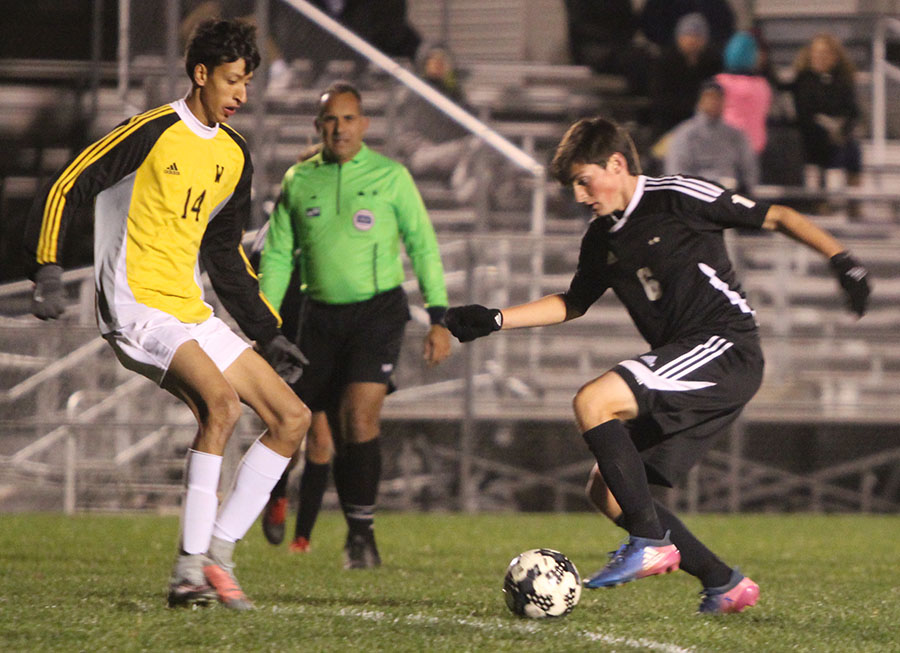 BVNW sophomore J.P. Pascarella attempts to create momentum offensively after being down a goal against Shawnee Mission West during the second half at the SMSC Oct. 24.