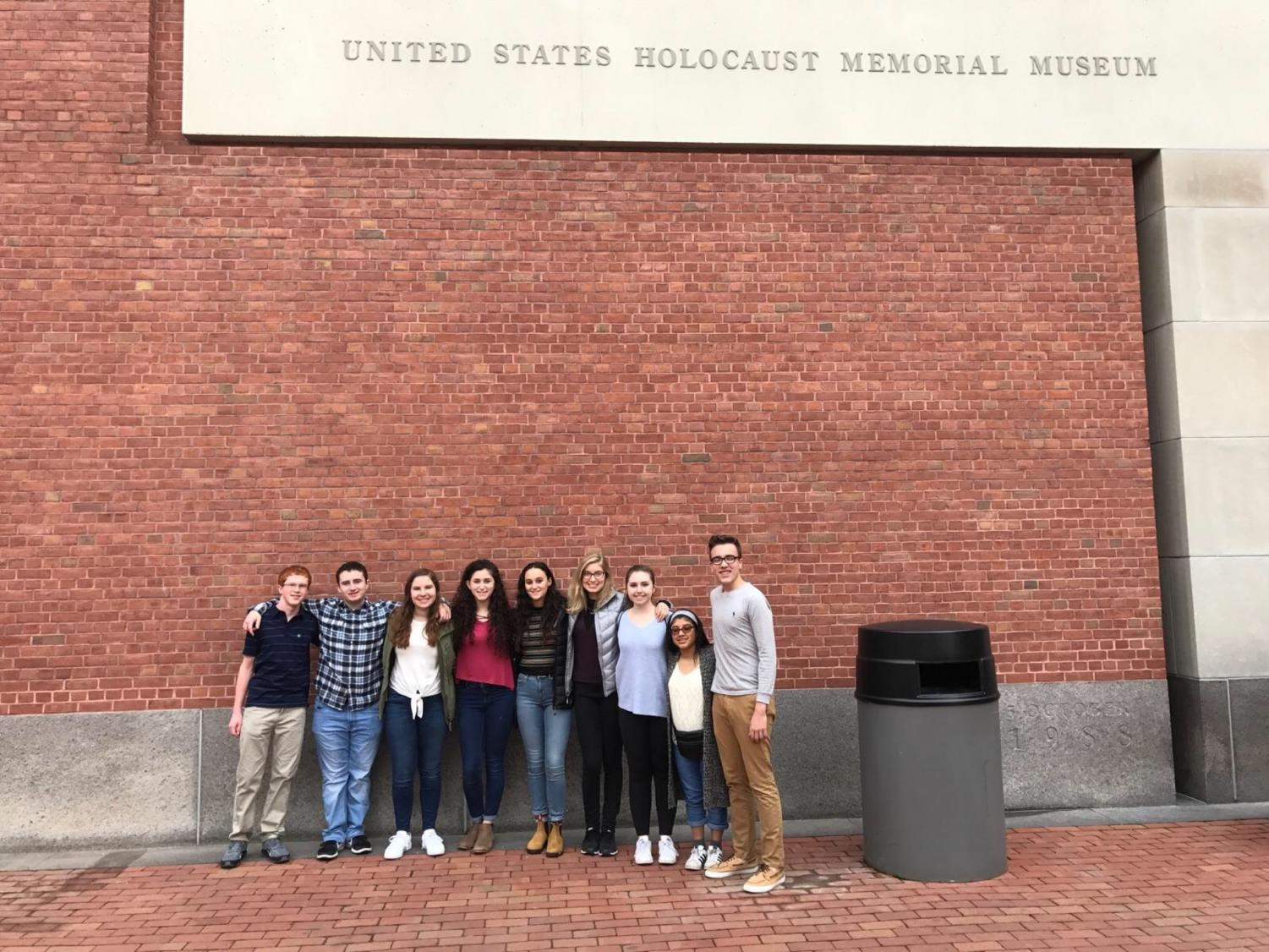 Sophomore Brayden Cardozo (second from the left) stands outside the United States Holocaust Memorial Museum with other students chosen through the Together We Remember program.