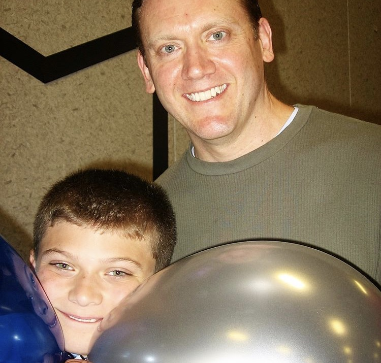 Senior Gavin Mullin with his father, Rob Mullin, after his fifth grade graduation.