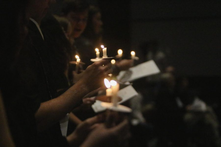 Inductees hold their candles as they recite the NHS pledge Nov. 14 at the PAC.