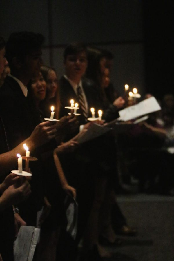 During the National Honors Society ceremony, inductees hold their lit candles Nov. 14 at the PAC.