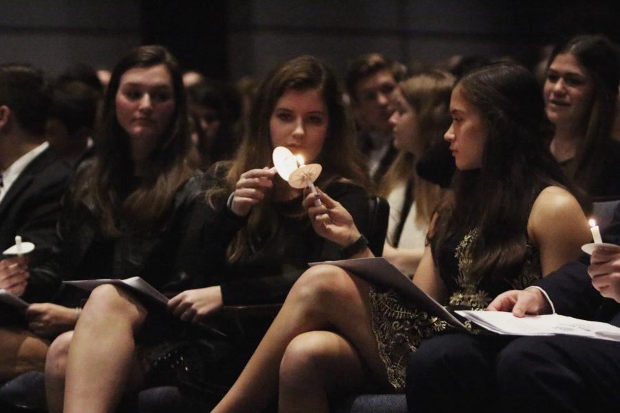 Inductees light their candles at the induction ceremony Nov. 14 at the PAC.