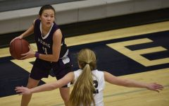 While trailing the Titans, junior Haley Shin squares up to find an open player against Lees Summit West on Dec. 15.