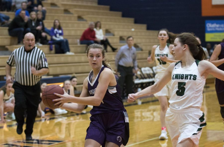 Sophomore forward Grace Coble (4) looks to pass the ball on Dec. 8.
