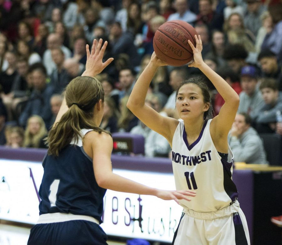 During+the+first+half%2C+junior+guard+Haley+Shin+looks+to+feed+the+ball+in+the+post.+Shin+finished+with+9+points+against+Blue+Valley+North+on+Dec.+20.