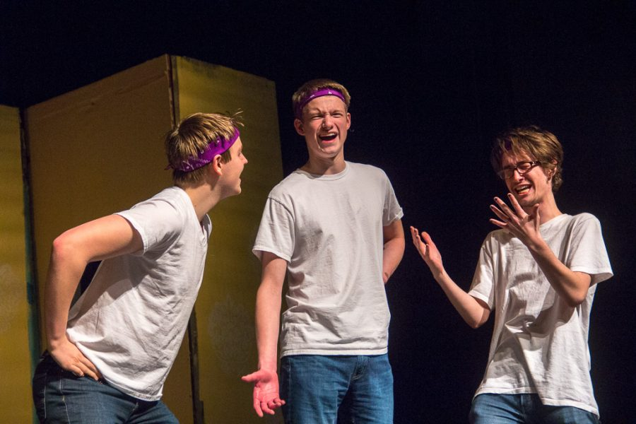 Junior Mark Doyle, senior Kyle Feather and senior Ben Holloway have a heated conversation during a scene.