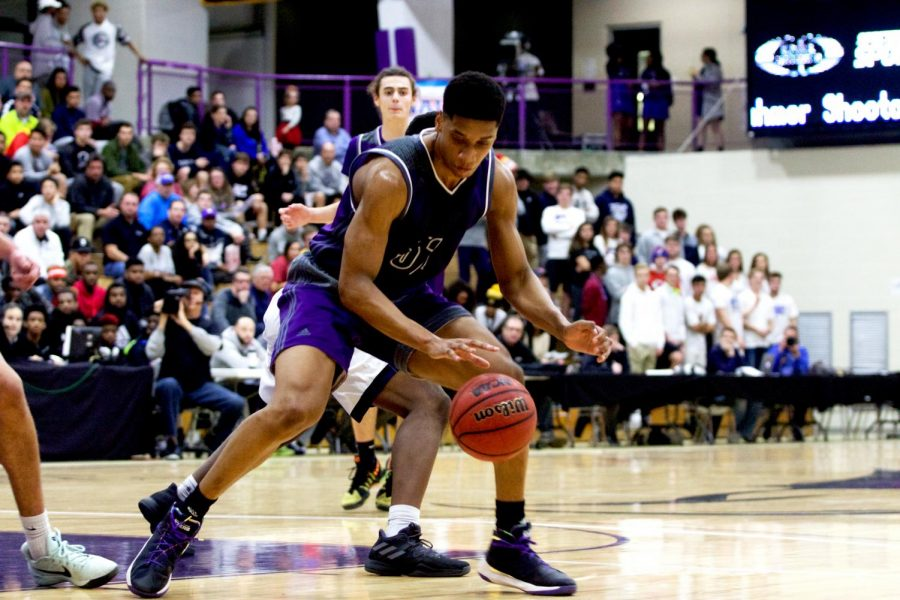 Senior forward Joe Pleasant (32) dribbles the ball in traffic during the first half at Avila University Dec. 16.