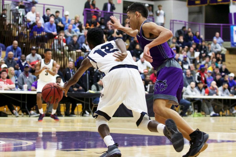 Senior guard Max Johnson defends an inbounds pass to Colby Baggett at Avila University Dec. 16.