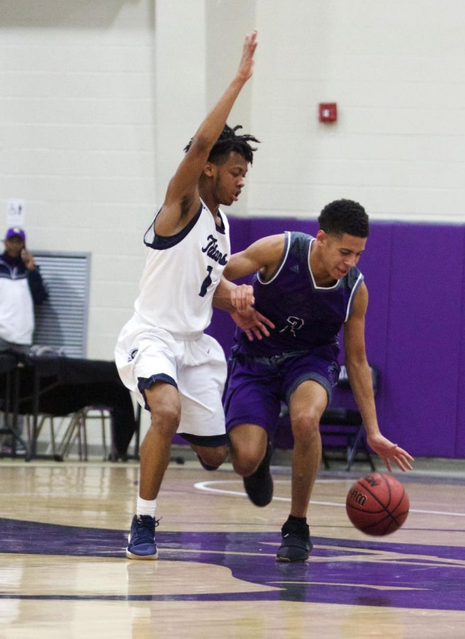 Senior guard Max Johnson (2) dribbles while being defended by Rich Johnson (1) at Avila University Dec. 16.