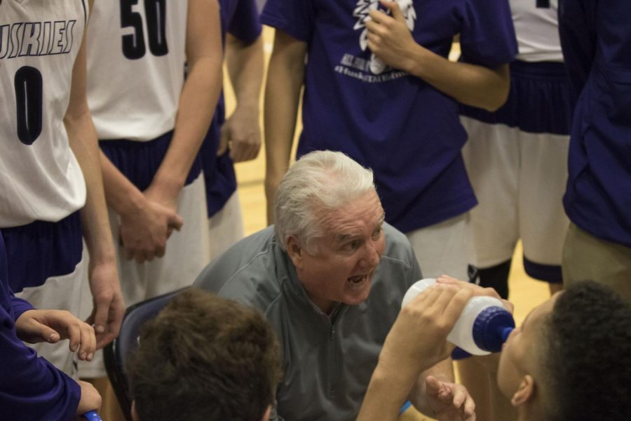 Head+coach+Ed+Fritz+talks+with+his+team+in+the+huddle+during+a+time+out+in+the+second+half+of+the+Huskies+game+against+Hogan+Prep+Dec.+1.+