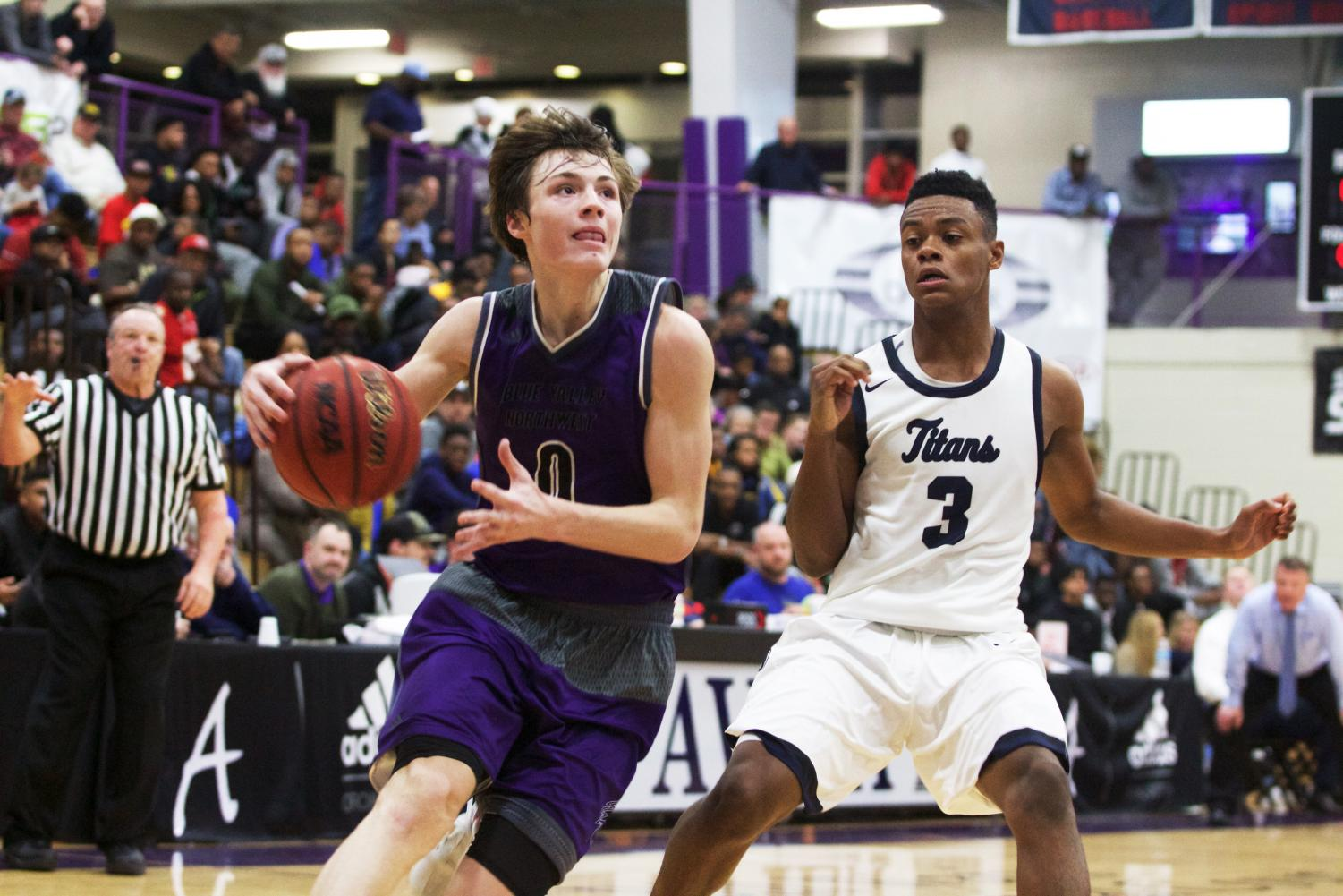 During the second half, senior guard Christian Braun (0) drives past Lee's Summit West guard Mario Goodrich (3) last year at Avila University Dec. 16.