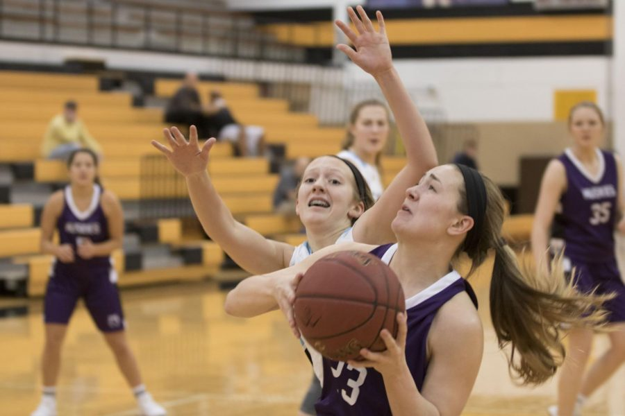 Senior guard Kate Kaufman drives and takes contact during the first half of the Huskies 34-29 loss.