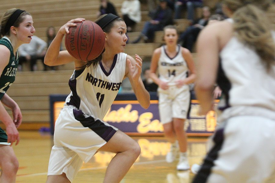 In the first half of the Huskies matchup with the Firebirds, junior guard Haley Shin (11) drives to the basket. Shin and the Huskies defeated the Firebirds 43-31.