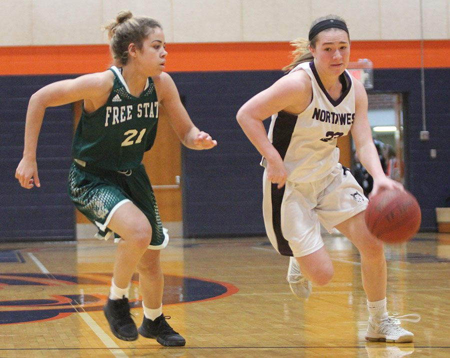 During the second half of the Blue Valley Northwests matchup with Lawrence Free State, senior guard Kate Kaufman dribbles the ball past an LFS defender. Kaufman scored 10 points in the Huskies win.