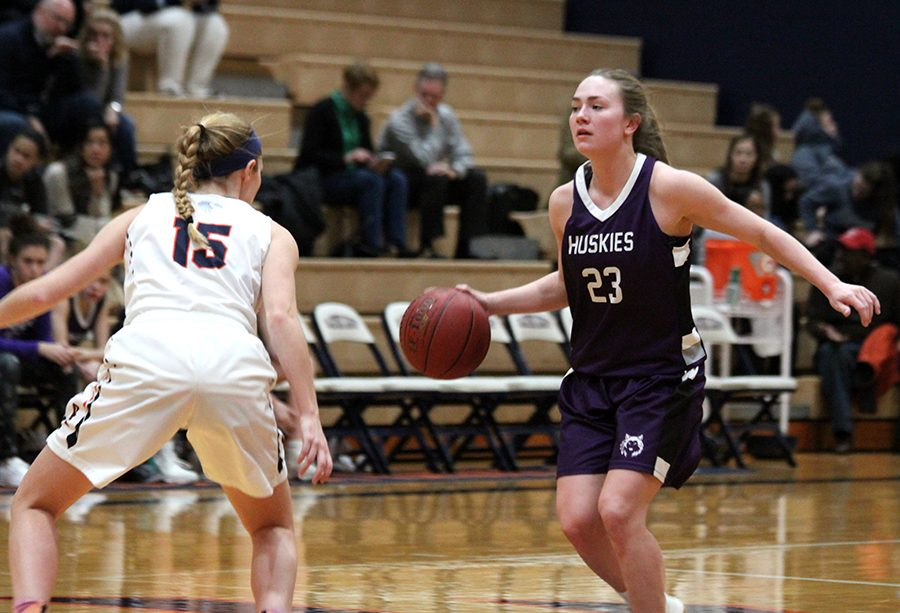 Senior guard Kate Kaufman dribbles the ball at the top of the key. The Huskies would lose to the Hawks 52-24.