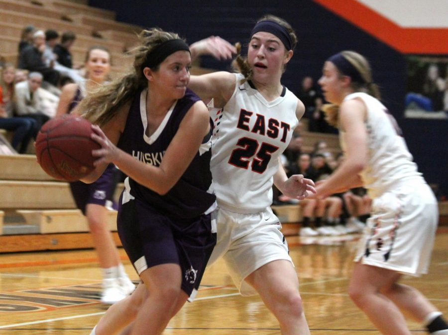 Senior guard Bridget Harrison drives baseline during the Huskies Tuesday night matchup with Olathe East. Harrison scored 14 points in the loss.