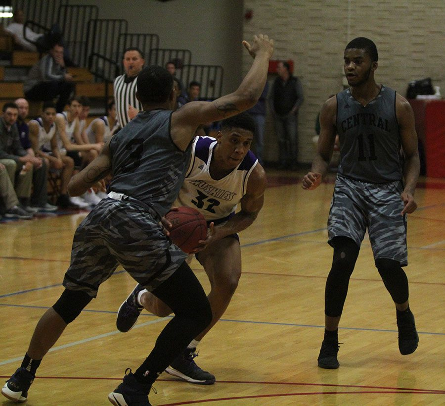 Senior forward Joe Pleasant (32) drives in transition in the first half of the Huskies 55-50 loss.