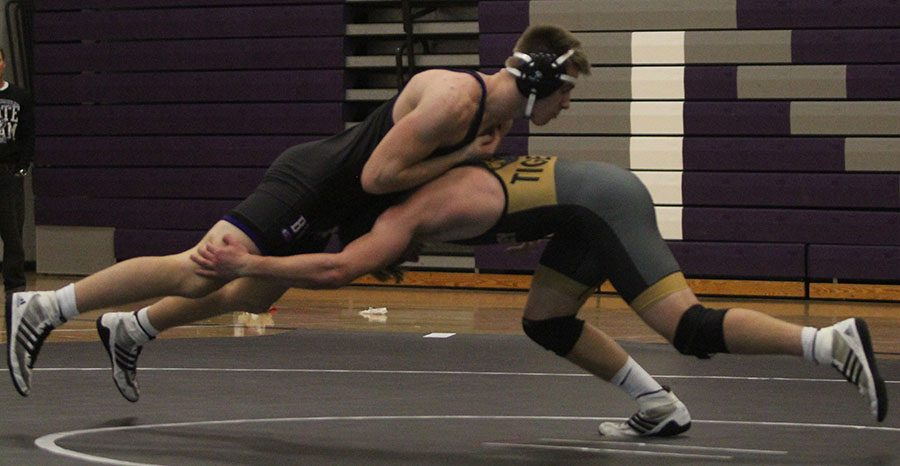 A tiger wrestler lifts senior Garrett Parks in the air during a match at BVNW on Dec. 13.