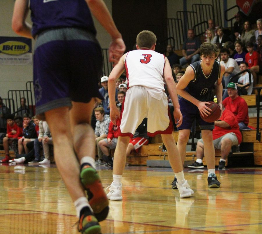 Junior guard Christian Braun (0) awaits a screen during the fourth quarter of the Huskies 73-56 win Friday night. Braun scored 13 points in the win.