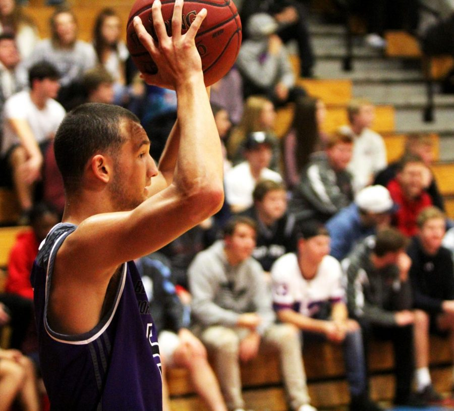 Senior guard Sam Ward (5) inbounds the ball during the second quarter of the Huskies 73-56 win.