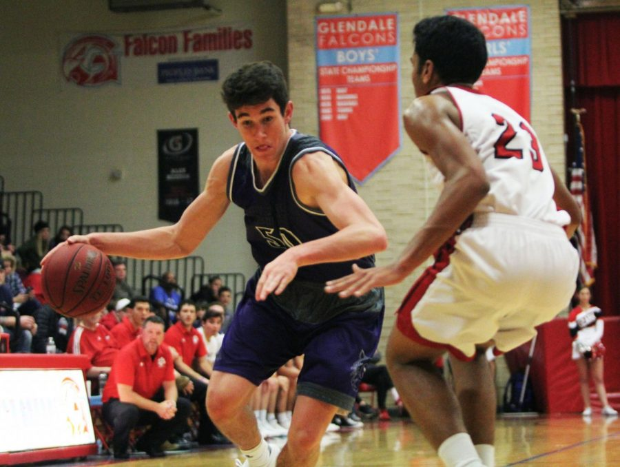 During the second half of the Huskies matchup with the Tigers, junior forward Matt Chapman (50) drives to the basket.