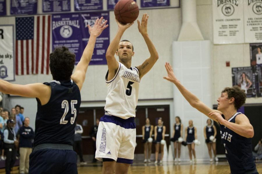 Senior guard Sam Ward (5) rises for a jump shot during the second half of the game between Blue Valley Northwest and Blue Valley North Dec. 20 at BVNW.
