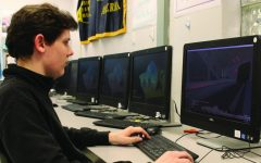 Junior Sam Rauter plays a computer game. Rauter is the President of the eSports club.
