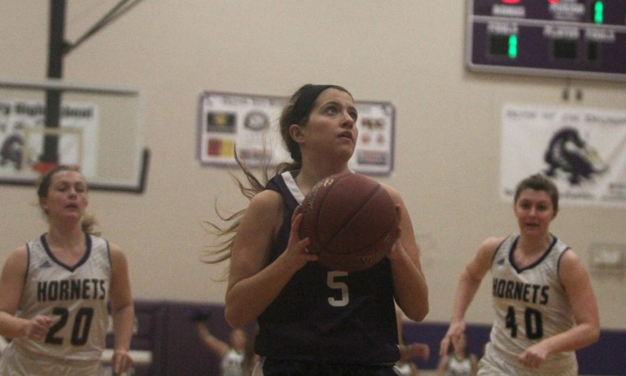Blue Valley Northwest senior guard Bridget Harrison (5) goes up for a layup during the Huskies matchup with North Kansas City at Pittsburg High Jan. 19.